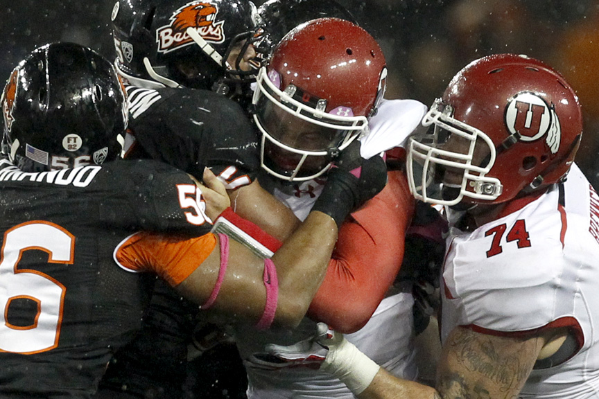 Utah Utes quarterback Travis Wilson (7) is sacked by Oregon State Beavers defensive end Rusty Fernando (56) Oregon State Beavers defensive end Scott Crichton (95) and Oregon State Beavers defensive end Rudolf Fifita (78) during the second half of the game at Reser Stadium Saturday October 20, 2012. Oregon State won the game 21-7.