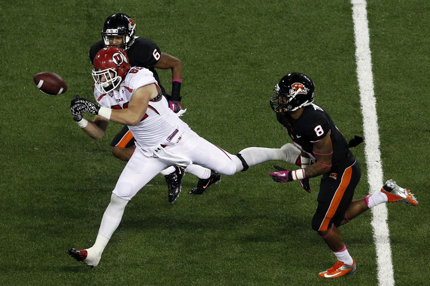 Utah Utes tight end Jake Murphy (82) can't make a potential touchdown catch while being defended by Oregon State Beavers cornerback Sean Martin (6) and Oregon State Beavers safety Tyrequek Zimmerman (8) during the second half of the game at Reser Stadium Saturday October 20, 2012. Oregon State won the game 21-7.
