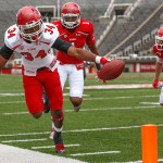James Poole (34) runs for the end zone during the University of Utah&#039;s Red-White Spring football game, Saturday April 20, 2013 in Salt Lake City. At right is Keith McGill