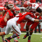 James Poole is tackled by Uaea Masina during the University of Utah&#039;s Red-White Spring football game, Saturday April 20, 2013 in Salt Lake City.
