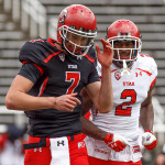 Quarterback Travis Wilson and Kenneth Scott celebrate a touchdown during the University of Utah&#039;s Red-White Spring football game, Saturday April 20, 2013 in Salt Lake City.